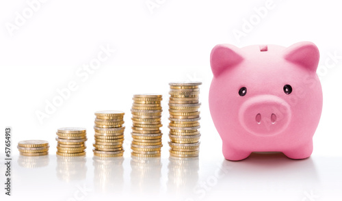Piggy bank with euro coin stacks - concept of increase