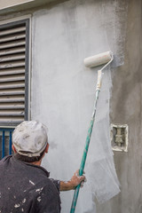builder worker painting a wall 2