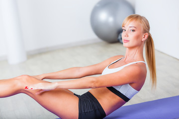 woman doing sit-ups on the floor