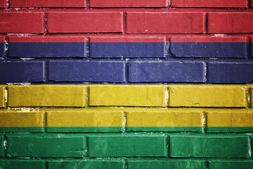 Mauritius flag on a textured brick wall