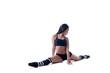 Studio shot of flexible slim girl sitting on split