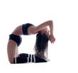 Harmonous flexible brunette posing in studio