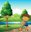 A kid at the riverbank playing with his bicycle