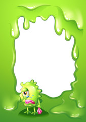 A border design with a green monster in tears