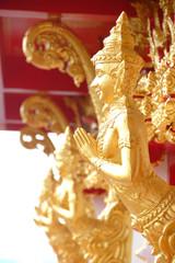 Golden guardian angel in temple