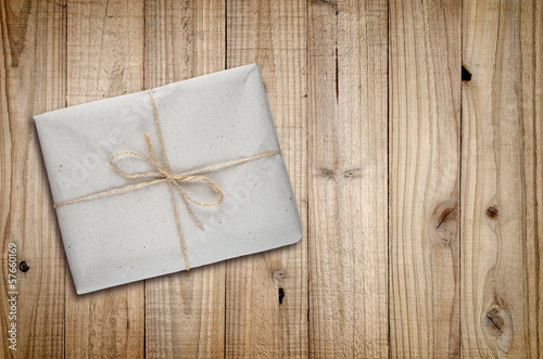 Package on old wooden background