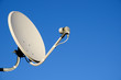 Leinwanddruck Bild - Satellite TV antenna on blue sky background
