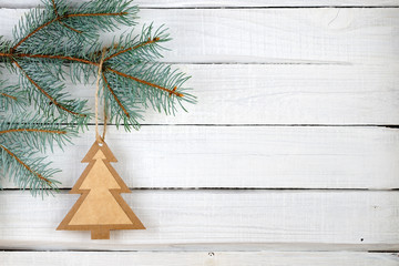 Paper Christmas tree and branches of blue spruce