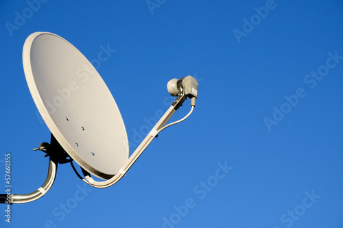 Leinwanddruck Bild Satellite TV antenna on blue sky background