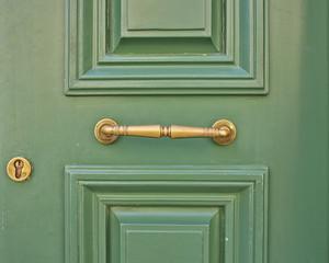 wooden green door closeup