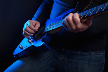 rock guitarist with blue guitar
