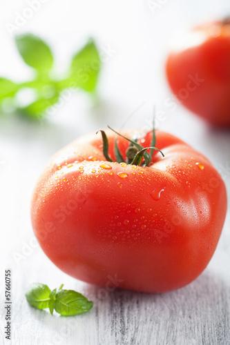 fresh big tomatoes and basil leaves