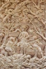 teak old wood engraving, in temple Thailand