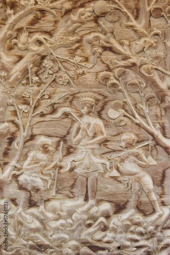 teak old wood engraving, in temple Thailand