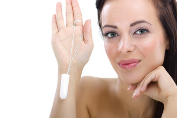 woman holding cotton hygienic tampon