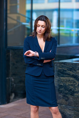 attractive mature businesswoman looking at watch