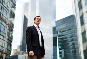 young businessman on skyscrapers background