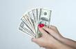 Fistful of dollars American bills in woman's hand