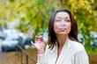 attractive mature woman smoking outside