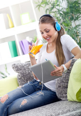 beautiful woman relaxing with music and drink juice