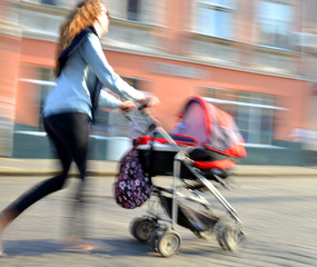 Mother walks with the child in the stroller