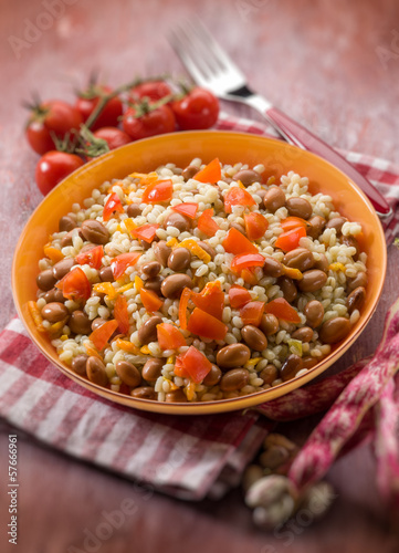 barley risotto with beans and tomatoes, selective focus