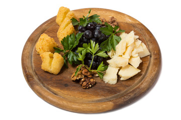 Assorted cheese with grapes and walnuts.