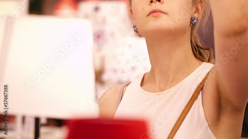 Young woman in a lamp store