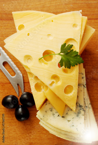 cut  Swiss and blue cheese