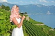 Woman tasting red wine in Lavaux, Switzerland