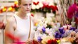 Beautiful young lady buying fresh flowers