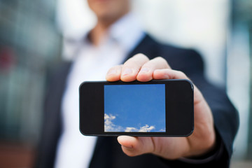 smartphone in the hand of businessman