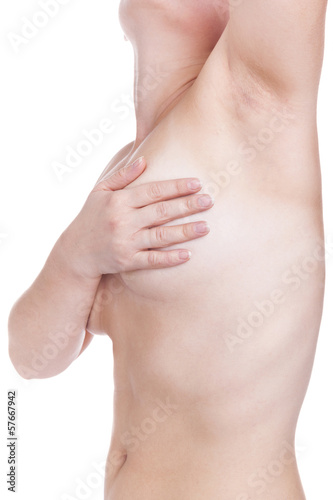 Woman examining breast, isolated on white