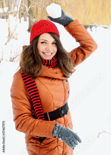 woman holding a snowball