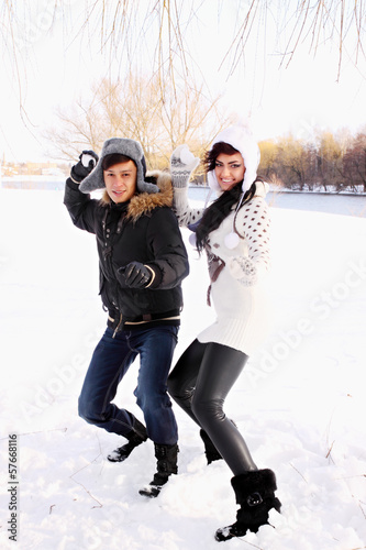 couple throwing snowballs
