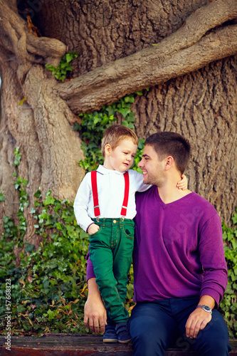 portrait of father and son in front of old tree