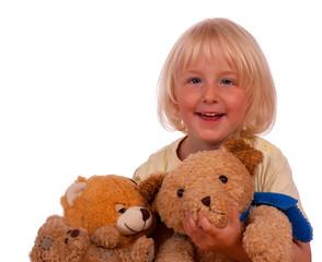 Blondes Mädchen mit Teddys