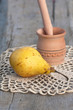 yellow juicy pear and wood  mortar