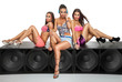 Sexy girls sitting on large speaker