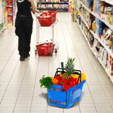 Shopping basket with groceries on shop of background