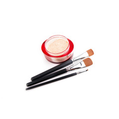 Three make-up brushes and powder isolated on white