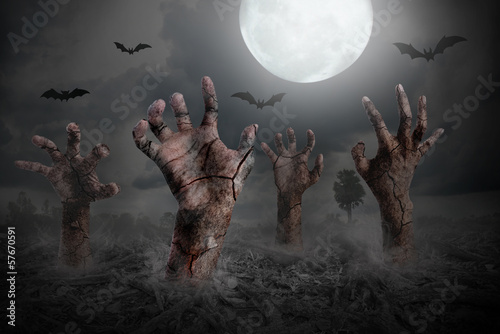 zombie hand rising out of the ground