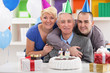 Portrait of happy family on 70th birthday
