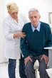 nurse helps senior man