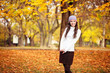 Cute girl in autumn park