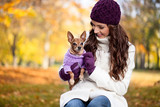 Cute woman with her Miniature Pinscher
