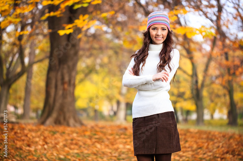 Portrait of girl in autumn park