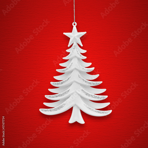 Christmas tree on a background of red paper