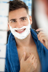 smiling handsome shaving man