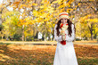Beautiful modern woman in autumn park